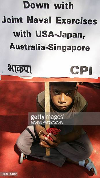 An Indian boy takes part in a protest by Left activists in New Delhi 05 September 2007 against a massive joint naval exercise which kicked off 04...