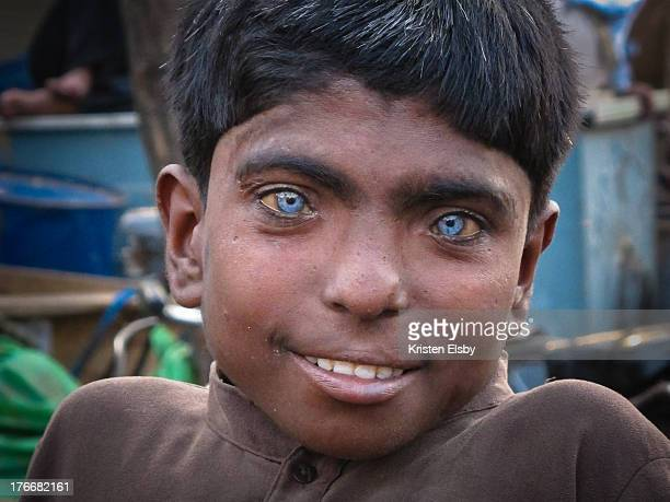CONTENT] An Indian boy with striking blue eyes poses for a portrait at Meena Bazaar in Old Delhi