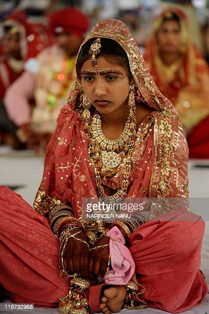 An Indian bride sits during a mass marriage ceremony for some 187 lowincome couples from the IndiaPakistan border area at Gurdwara Baba Jallan Dass...
