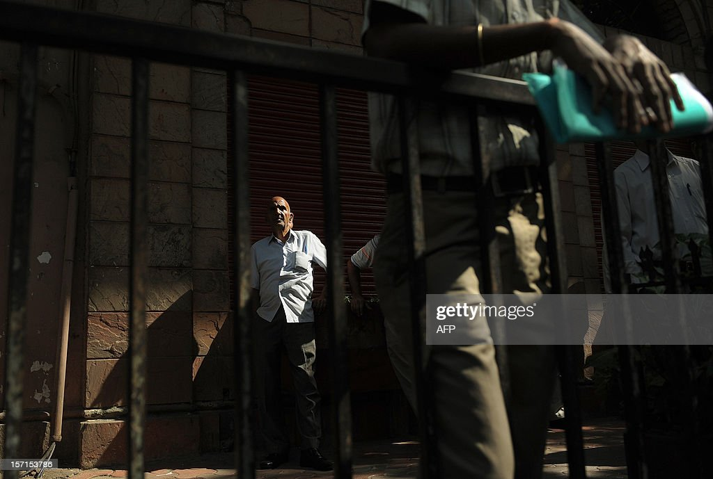 An Indian bystander watches share prices on the digital broadcast on the facade of the Bombay Stock Exchange (BSE) in Mumbai on November 29, 2012. Asian markets mostly tracked Wall Street higher on November 29 as investors following US talks aimed at avoiding a fiscal cliff welcomed positive comments from both sides of the political divide.