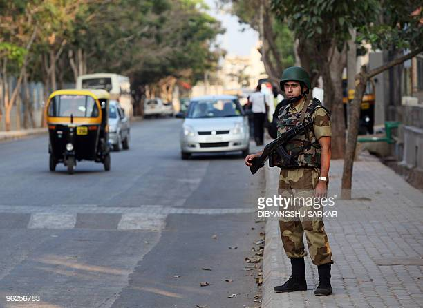 An Indian Central Industrial Security Force officer patrols Electronics City in Bangalore on January 29 2010 The entire complex housing 157 Indian...