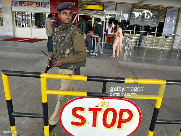 An Indian Central Industrial Security Force officer stands guard at an entry point of Bagdogra airport on the outskirts of Siliguri on December 5...