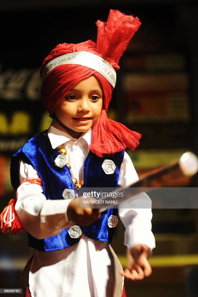 an-indian-child-in-traditional-punjabi-bhangra-dress-dances-in-the-picture-id89056762 Punjabi Dress for Kids- 30 Best Punjabi Outfits for Children
