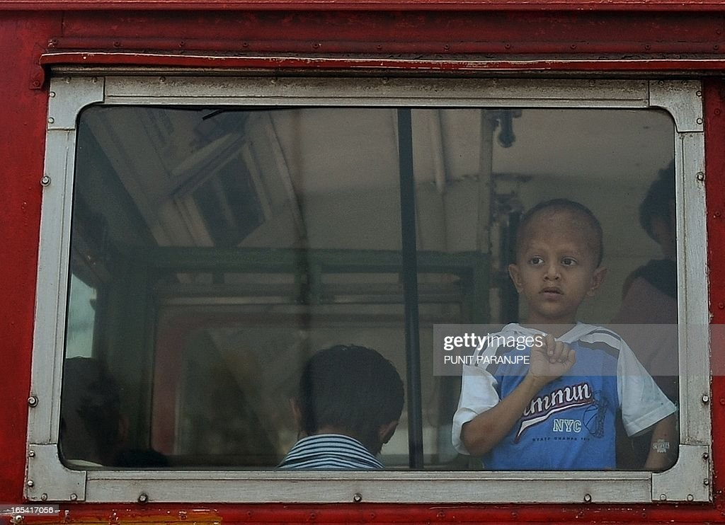 An Indian child looks out from a local passenger bus in Mumbai on April 4, 2013. New data showed that while India's population remains largely rural, its urban population has grown to 377 million, or 31.1 per cent of the 1.21 billion population, from 286 million or 27.8 per cent of the population in 2001.