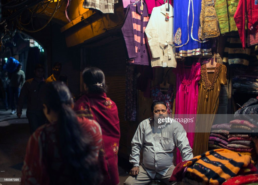 An Indian clothing vendor looks at potential customers in the Old Quarters in New Delhi on January 30, 2013. Emerging economies are set to grow faster than the developed economies over the next four decades and India is likely to become one of the three largest economies by 2050, said a Pricewaterhouse Coopers report. AFP PHOTO/ Andrew Caballero-Reynolds