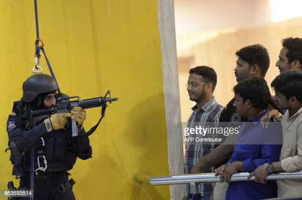 An Indian commando from the National Security Guard demonstrates combat skills during an event in Hyderabad on September 25 2017 Security personnel...