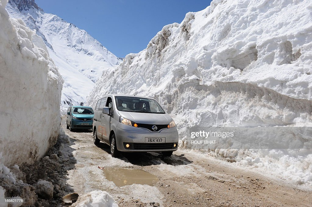 An Indian convoy negotiates the Srinagar-Leh highway in Zojila Pass about 108 kms, 67 miles, east of Srinagar on April 6, 2013. The 443 km (275 mile) long highway was opened for the season by Indian Army authorities after the remaining snow at Zojila Pass, some 3,530 metres (11,581 feet) above sea level, had been cleared. The pass connects Kashmir with the Buddhist-dominated Ladakh region, a famous tourist destination known for its monasteries, landscapes and mountains. AFP PHOTO/ Rouf BHAT