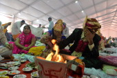 An Indian couple perform a Hindu ritual during a mass wedding in New Delhi on June 15 2014 Some 92 lowincome and disabled couples tied the knot in a...