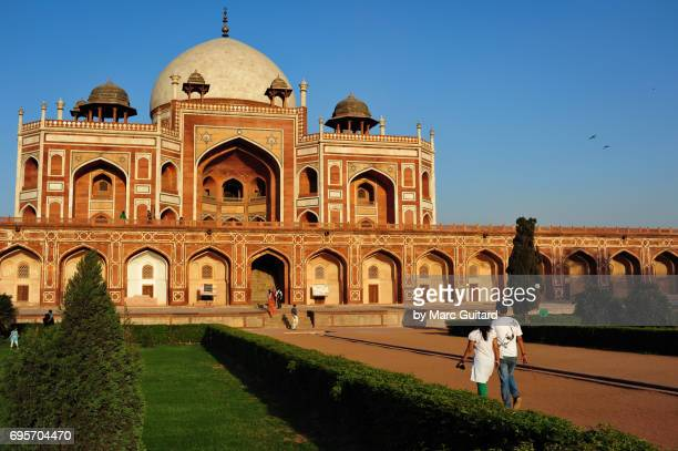 An Indian couple walking towards Humayun's Tomb, Delhi, India