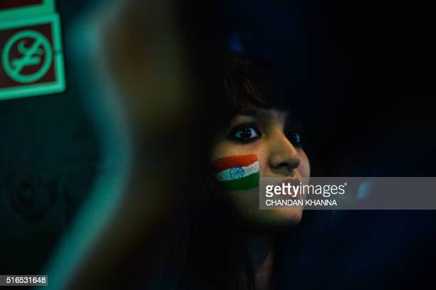 An Indian cricket fan celebrates in New Delhi on March 19 after India beat Pakistan to win the World T20 cricket tournament match in the eastern...