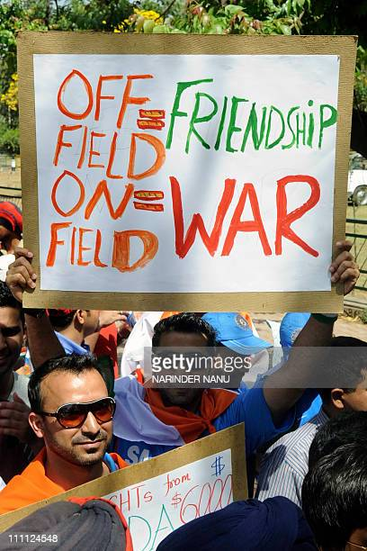 An Indian cricket fan holds up a placard before the start of the Cricket World Cup semifinal match between India and Pakistan outside The Punjab...