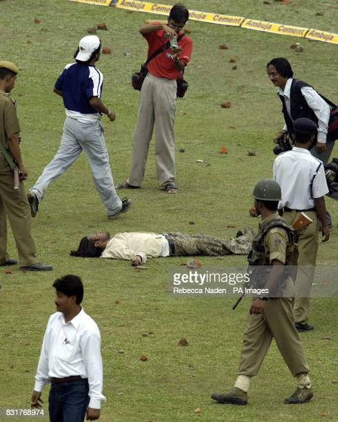 An Indian cricket fan lies injured after attempting to access the ground after the 5th ODI between England and India was abandoned at the Nehru...