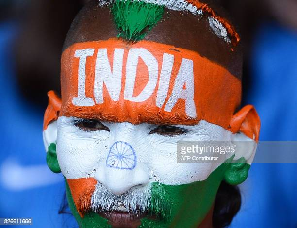 An Indian cricket fan looks on during the third day of the second Test match between Sri Lanka and India at the Sinhalese Sports Club Ground in...