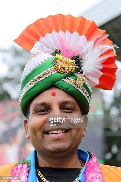 An Indian cricket fan smiles as he attends the One day International Cricket Match between India and South Africa at SAHARA Stadium Kingsmead in...