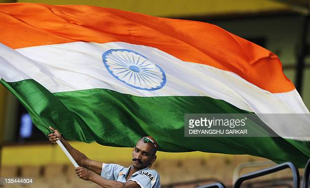 An Indian cricket fan wave the national flag during a training session ahead of the final One Day International cricket match between India and West...