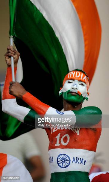 An Indian cricket supporter in full body paint waving an Indian flag during the ICC Cricket World Cup match against England in Banglaore on February...
