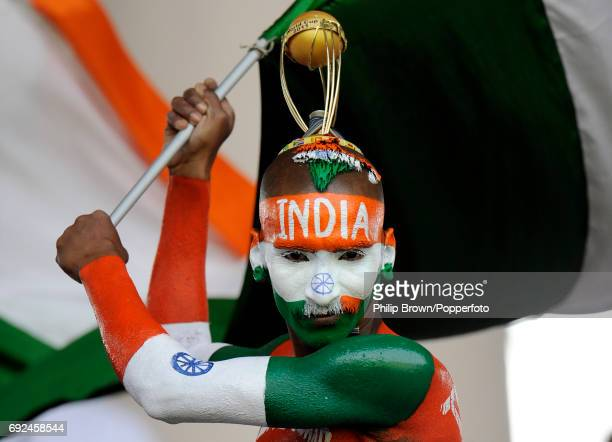An Indian cricket supporter in full body paint waving an Indian flag and wearing a Cricket World Cup headdress during the ICC Cricket World Cup match...