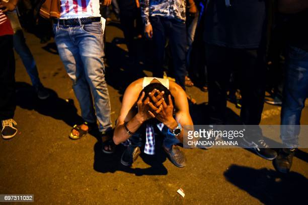 An Indian cricket supporter reacts as Pakistan won the ICC Champions Trophy final cricket match against India in New Delhi on June 18 2017 Pakistan...