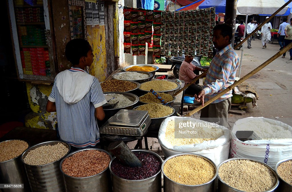 An indian customer buys pulse in a whole sale grocery shop, in old market of Allahabad on May 27,2016.A United nation's latest report has estimated that India could lose $49 billion (more than 3 lakh crore) of its GDP if global food prices double. India will see the second highest loss after china,which is estimated to lose $161 billion of its GDP because of volatile food prices. The report said the world is likely to suffer from more volatile food commodity prices because of several reasons, including climate change and rising populations.
