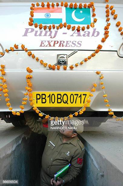 An Indian customs security person checks the AmritsarLahoreAmritsar bus at the IndoPak Wagah Border 24 January 2006 The bus left the Sikh pilgrimage...