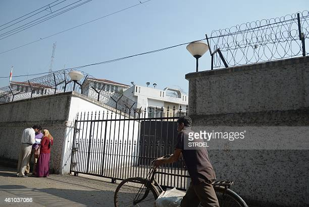 An Indian cyclist walks past the gates of The ConsulateGeneral of Japan in Kolkata on January 5 2015 Police in India's eastern city of Kolkata have...