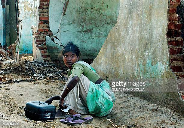 An Indian Dalit woman sits in her village ofKeshvanpalayam some 30 kms from Nagapattinam07 January 2005 as their parents have gone in search of food...