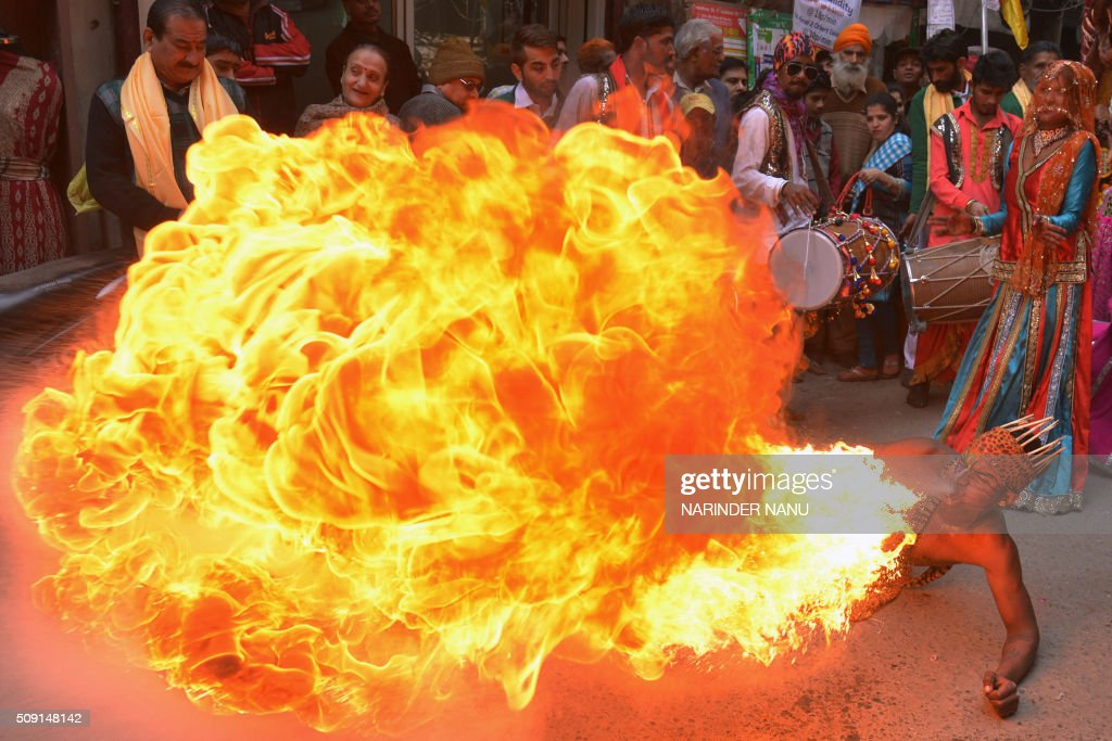 An Indian dancer performs a fire breathing act during a procession to mark the 661st anniversary of the birth of Hindu guru Bawa Lal Dayal Maharaj in Amritsar on February 9, 2016. Bawa Lal Dayal Maharaj, a popular leader of his time, is especially revered by devotees of a temple in the town of Dhyanpur, some 45 kms north of Amritsar. AFP PHOTO/NARINDER NANU / AFP / NARINDER NANU