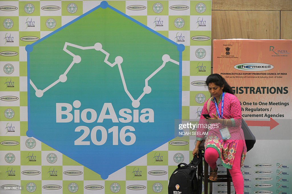 An Indian delegate checks her phone during the BioAsia 2016 conference at the Hyderabad International Convention Centre (HICC) in Hyderabad on February 9, 2016. The 13th edition of BioAsia is expecting strategic partnerships and investment announcements of over 100 million USD over the course of the three-day event. AFP PHOTO / Noah SEELAM / AFP / NOAH SEELAM