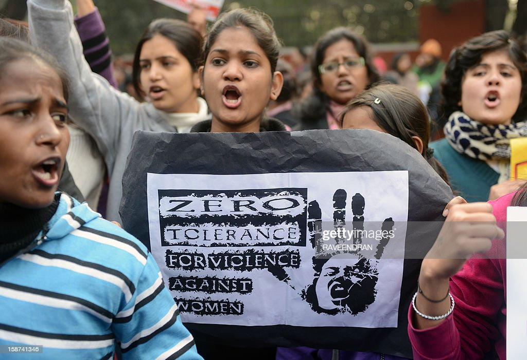 An Indian demonstrator holds a placard during a protest calling for better safety for women following the rape of a student in the Indian capital, in New Delhi on December 27, 2012. An Indian student who was left fighting for her life after being brutally gang raped on a bus in New Delhi arrived December 27 in Singapore for treatment at a leading hospital. The attack sparked a wave of protests across India in which a policeman died and more than 100 police and protestors were injured.