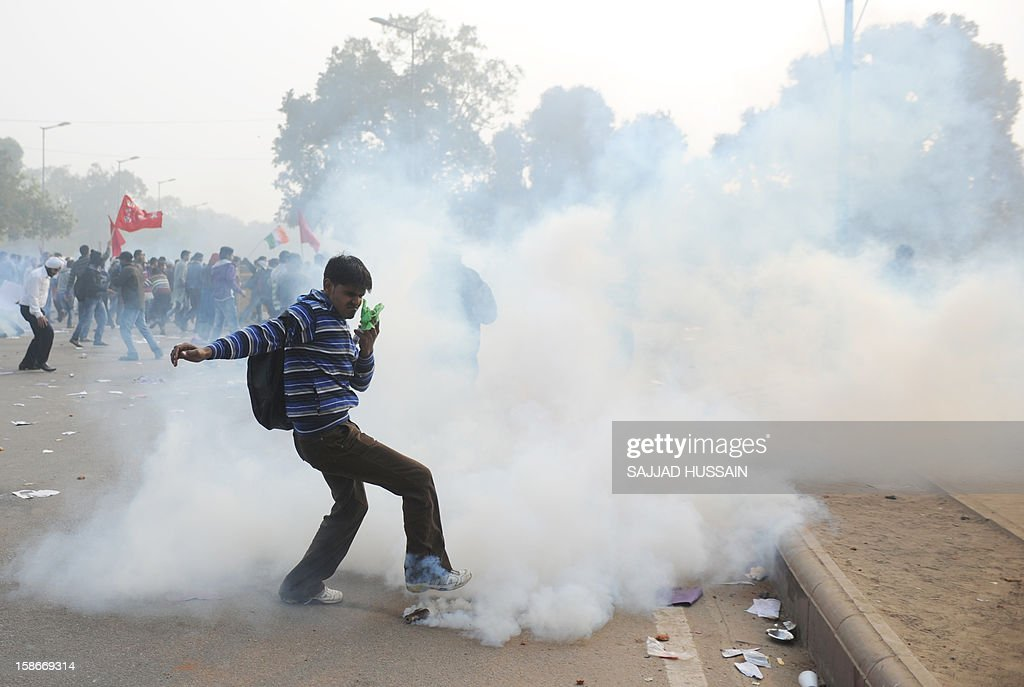 An Indian demonstrator kicks a tear gas canister during a protest calling for better safety for women following the rape of a student last week, in front the India Gate monument in New Delhi on December 23, 2012. In the biggest protest so far, several thousand college students rallied at the India Gate monument in the heart of the capital where they were baton-charged, water cannoned and tear gassed by the police. AFP PHOTO/ Sajjad Hussain