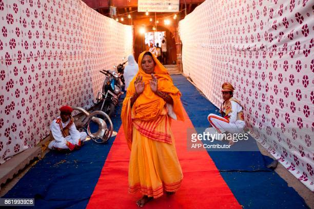 An Indian devotee leaves Gopinath temple after the wedding ceremony of Vinita Devi a former widow and Rakesh Kumar in Vrindavan on October 16 2017...