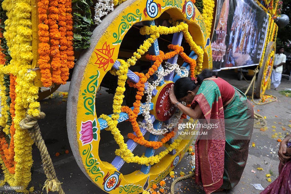 An Indian devotee of The International Society of Krishna Conciousness (ISKON) performs a ritual or 'puja' at the start of the Sri Jagannatha Ratha Yatra in Hyderabad on July 10, 2013. According to mythology, the Ratha Yatra dates back some 5,000 years when Hindu god Krishna, along with his older brother Balaram and sister Subhadra, were pulled on a chariot from Kurukshetra to Vrindavana by Krishna's devotees. AFP PHOTO / Noah SEELAM