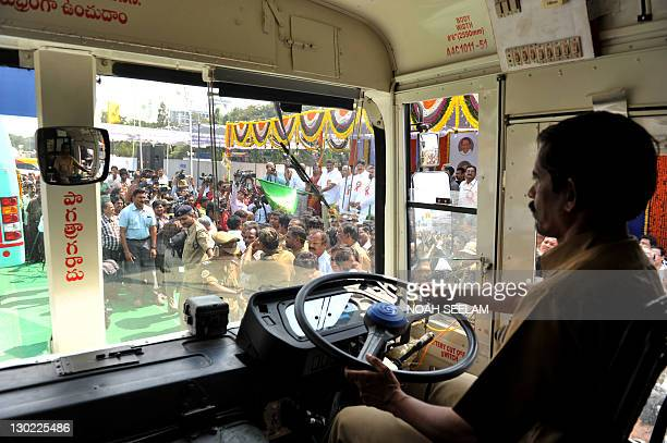 An Indian driver of The Andhra Pradesh State Road Transport Corporation drives a newly equipped compressed natural gas bus during a launch function...