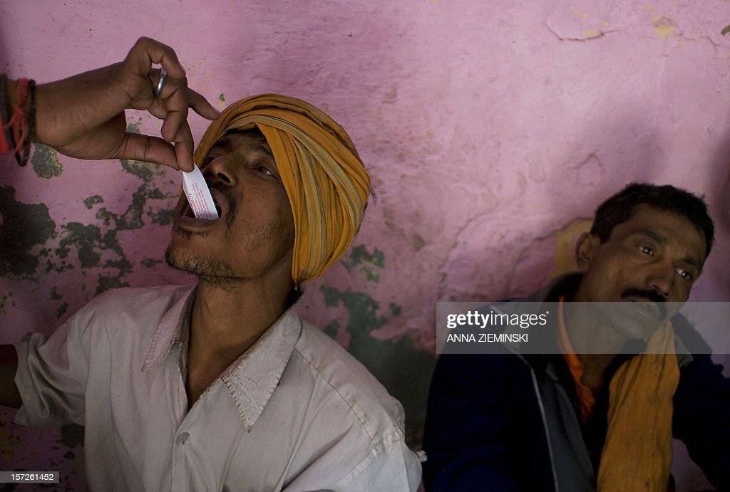 An Indian drug user is given an oral form of 'buprenorphine' as part of a harm reduction program at a drop-in centre in the old sector of New Delhi on December 1, 2012. Drug use in India is on the rise but there are no proper statistics on the number of people suffering from this 'hidden disease' with the first and last national survey on drug abuse carried out in 2000-01 and showed a figure of 70 million drug users in the country. AFP PHOTO/ Anna ZIEMINSKI