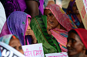 An Indian elderly woman supporter reacts during Bihar's Chief Minister Nitish Kumar's speech during the divisional political summit of JD in...