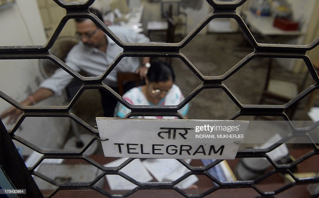 An Indian employee inspects a telegram at a counter in Mumbai on July 14, 2013. Thousands of Indians crammed into telegram offices to send souvenir messages to friends and family in a last-minute rush before the service shuts down. July 14, 2013, is the last day that messages will be accepted by the 162-year-old service, the last major commercial telegram operation. In the days before mobile phones and the Internet, the telegram network was the main form of long-distance communication, with 20 million messages dispatched from India during the subcontinent's bloody partition in 1947.