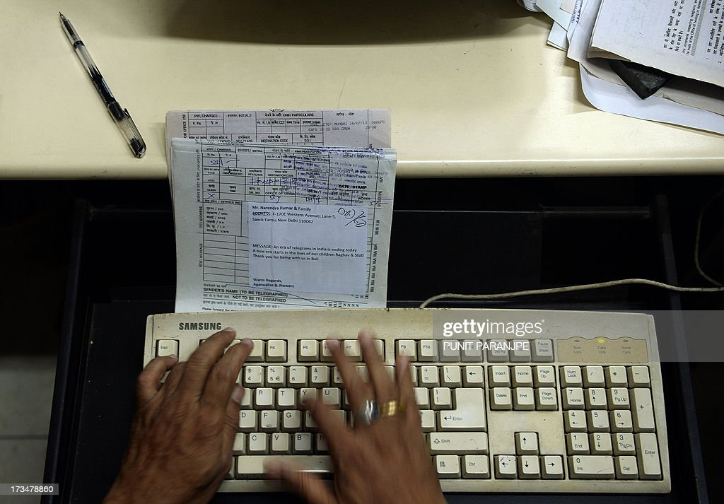 An Indian employee types in a pending telegram message, which was booked on July 14, at the Central Telegraph Office in Mumbai on July 15, 2013. After 162 years of connecting people, India disbanded the world's last major telegram service and its legions of cycle-borne delivery workers - July 14 was the last day that messages were accepted by the service. In the days before mobile phones and the Internet, the telegram network was the main form of long-distance communication, with 20 million messages dispatched from India during the subcontinent's bloody partition in 1947.
