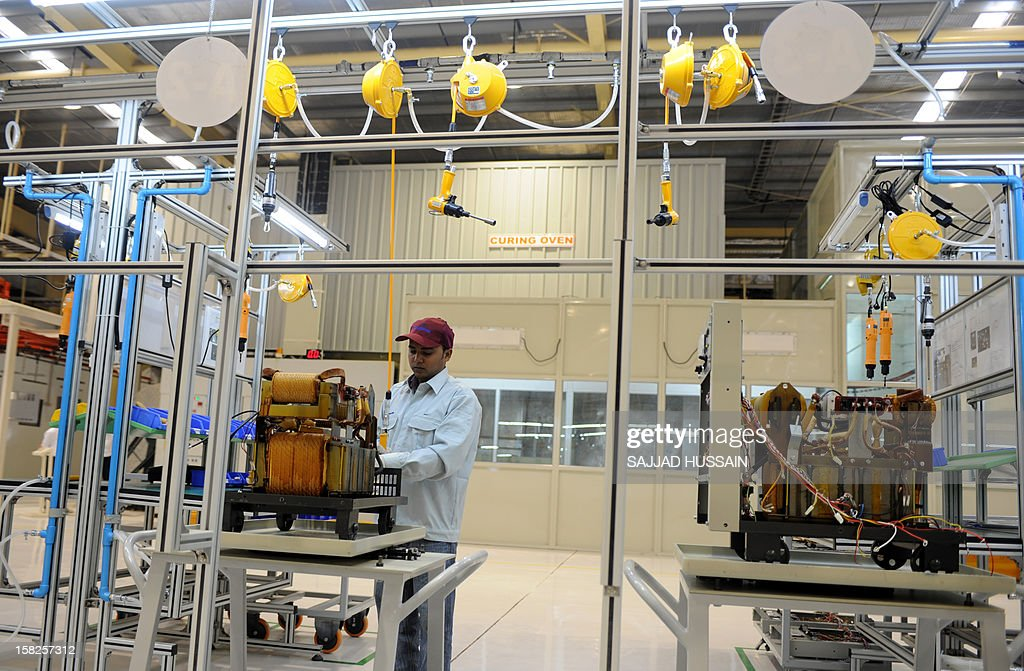 An Indian employee works at the Panasonic 'eco ideas' factory at Jhajjar in Haryana on December 12, 2012. Panasonic India today announced the expansion of its presence in India with the opening of its first model 'eco ideas' factory. This is the company's latest initiative to showcase best practices in sustainable manufacturing and raise level of eco consciouness in the community through outreach activities. AFP PHOTO/SAJJAD HUSSAIN