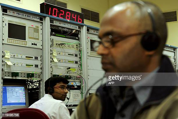 An Indian engineer makes adjustments at the Satellite Control Earth Station7 of Indian Space Research Organisation's Master Control Facility in the...
