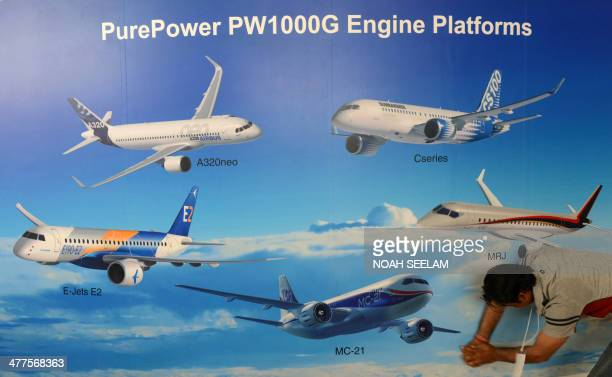 An Indian exhibitor prepares a display stand at Begumpet Airport in Hyderabad on March 10 ahead of The India Aviation 2014 show The fourth edition of...
