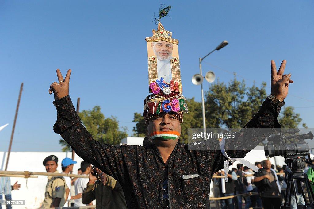 An Indian fan displays a crown of Gujarat Chief Minister, Narendra Modi outside the Sardar Patel Gujarat Stadium, Motera near Ahmedabad on December 28, 2012. Pakistan and India played a cricket Twenty20 match at Motera stadium. AFP PHOTO/ Sam PANTHAKY