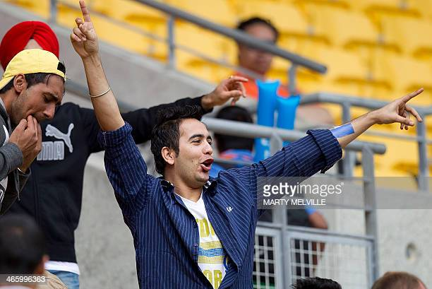 An Indian fan enjoys the cricket during the fifth and final international one day cricket match between New Zealand and India in Wellington at...