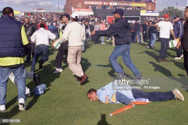 An Indian fan is kicked in the head and stamped on after the India win over Pakistan in their Super SIx Cricket World Cup match at Old Trafford in...