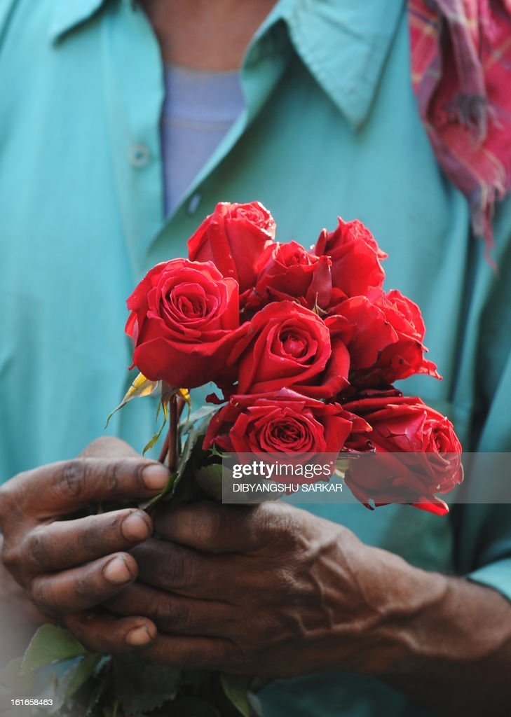 An Indian farmer arranges flowers at a wholesale flower market in Kolkata, on February 14, 2013. On Valentine's day the floriculture business in the city is booming because of the increased demand nationally. AFP PHOTO/ Dibyangshu SARKAR