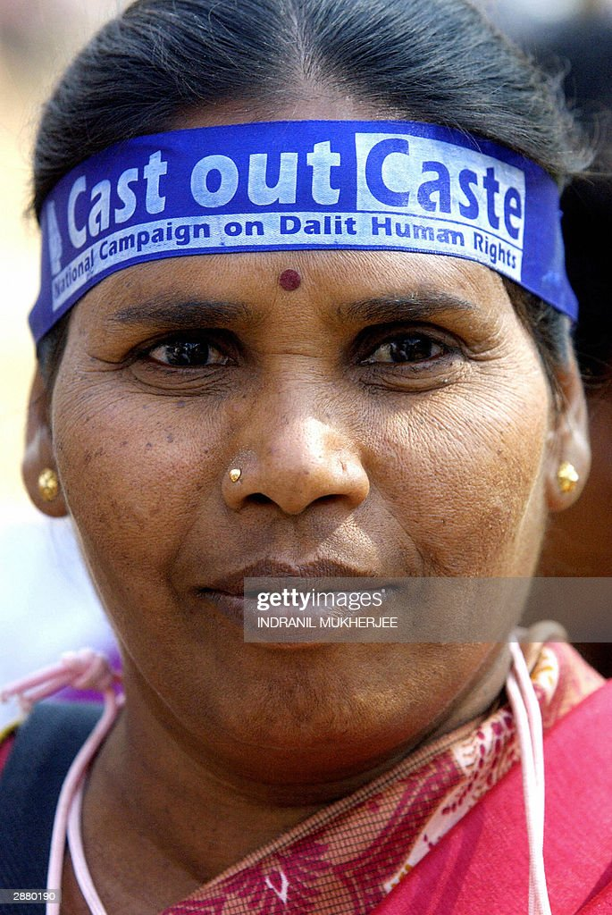 An Indian female Dalit member of Hinduism lowest caste wears a headband bearing the slogan 'Cast Out Caste' as she marches at the 2004 World Social...