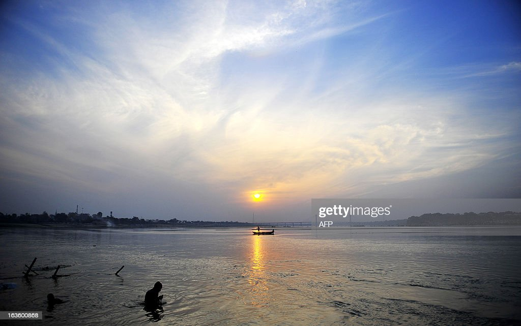 An Indian fisherman fishes on the Sangam, the confluence of the Yamuna and Ganges river on March 13, 2013. New data showed that while India's population remains largely rural, its urban population has grown to 377 million, or 31.1 per cent of the 1.21 billion population, from 286 million or 27.8 per cent of the population in 2001.