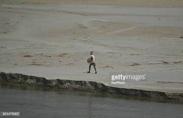 An indian fisherman moves towards river bank of River Gangga to catch fishes during a hot day in Allahabad on June 12015