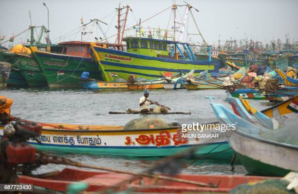 An Indian fisherman paddles a wooden boat through a harbour in Chennai on May 24 2017 Authorities in the southern Indian state of Tamil Nadu have...