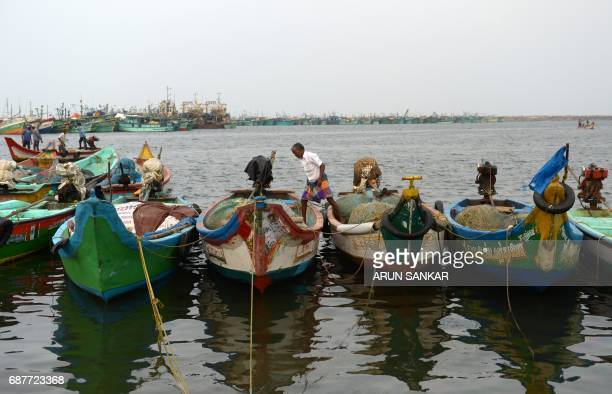 An Indian fisherman walks over mechanised boats at a harbour in Chennai on May 24 2017 Authorities in the southern Indian state of Tamil Nadu have...