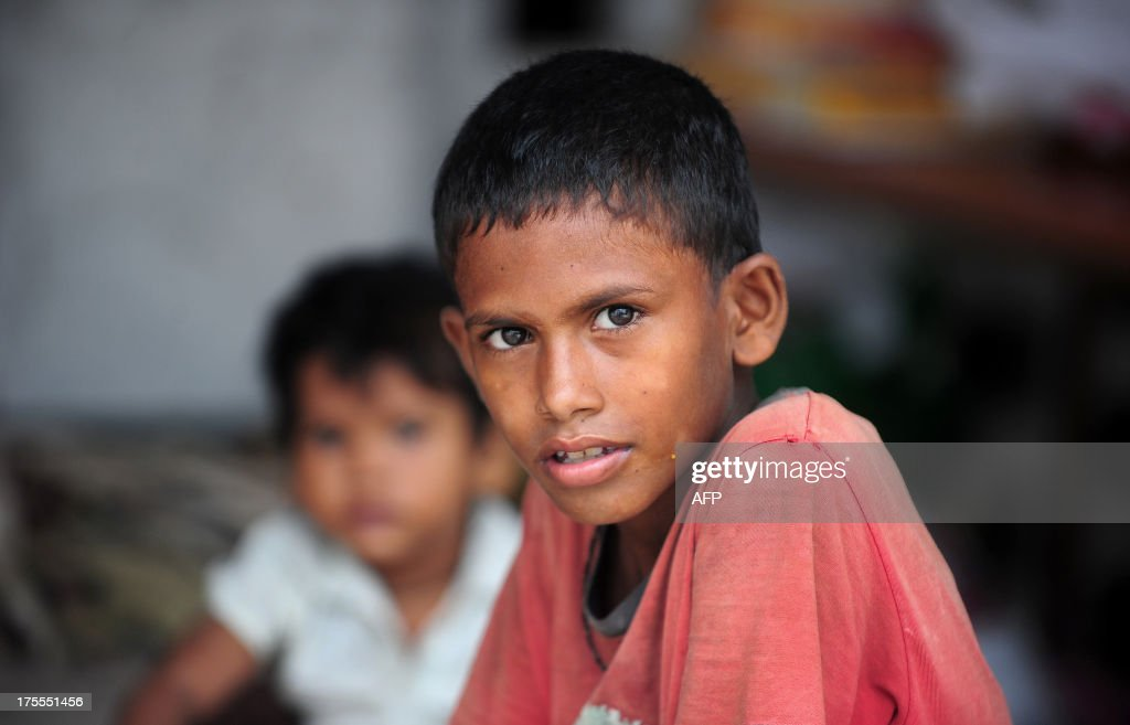 An Indian flood-affected boy, Imran rests at a local shelter in Allahabad on August 4, 2013. The monsoon, which covers the subcontinent from June to September and usually brings flooding, accounts for about 80 percent of India's annual rainfall.